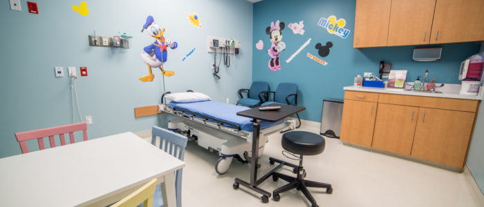 pediatric room with guest chairs