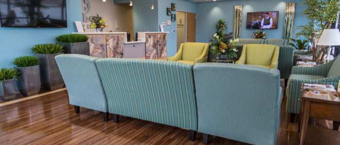emergency center waiting area with seating and plants