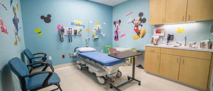 pediatric room with guest chairs at emergency center