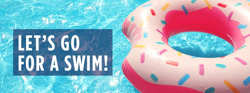 Let's go for a swim! - Pink sprinkled donut pool float floating in the swimming pool