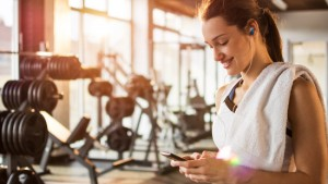 Woman Using Mobile Device During Workout